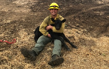 Firefighter saves calf | Image courtesy Douglas Forest Protective Association